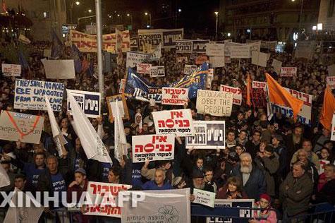 تقرير اخبارى: المستوطنون ينظمون تظاهرة ضخمة فى القدس ضد تجميد البناء