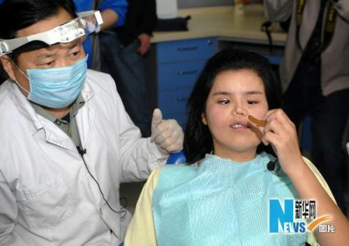 Doctors have successfully performed the last of seven operations on a 22-year-old Chinese woman born with a rare facial-deformity.