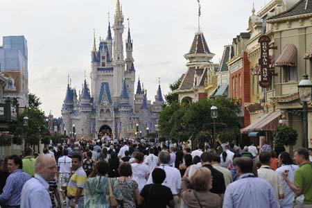 People visit Disney's Magic Kingdom Park during a welcome event prior to the 2010 International POW WOW in Orlando, Florida, the United States, May 16, 2010. The annual premier international marketplace for travel to the United States, will gather over 1,000 U.S. travel organizations and worldwide tourism operators. [Xinhua photo]