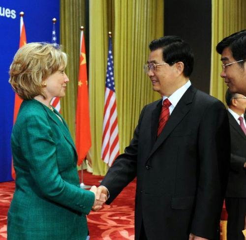Chinese President Hu Jintao (R) shakes hands with U.S. Secretary of State Hillary Clinton as he attends the opening ceremony of the second round of China-U.S. strategic and economic dialogue at the Great Hall of the People in Beijing, capital of China, May 24, 2010.(Xinhua/Rao Aimin)