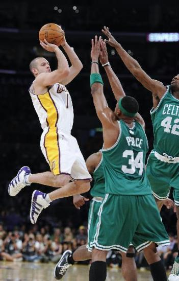Boston Celtics beat host Los Angeles Lakers 103-94, drawing the best of seven series 1-1 at the 2010 National Basketball Association finals Sunday in Los Angeles. (Xinhua Photo)