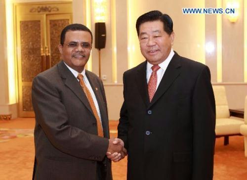 Jia Qinglin (R), chairman of the National Committee of the Chinese People's Political Consultative Conference (CPPCC), shakes hands with Ethiopian Speaker of the House of Federation Degefi Bula at the Great Hall of the People in Beijing, capital of China, June 22, 2010.(Xinhua/Pang Xinglei)