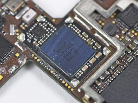 The Broadcom GPS receiver is displayed during iFixit's teardown of the iPhone 4 in San Luis Obispo, California June 22, 2010. Apple Inc's hot-selling next-generation iPhone sports chips from Samsung Electronics, Micron Technology and STMicroelectronics, according to an early teardown, or disassembly analysis by technology firm iFixit. The well-reviewed iPhone 4 goes on sale on Thursday in five of the world's biggest economies -- China and its guarded telecoms sector being a notable exception -- and consumers hoping to score the device are expected to throng stores.(Xinhua/Reuters Photo)