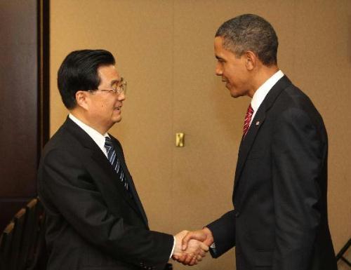 ChinesePresidentHuJintao(L)meetswithU.S.PresidentBarackObamainToronto,Canada,June26,2010.(Xinhua/MaZhancheng)