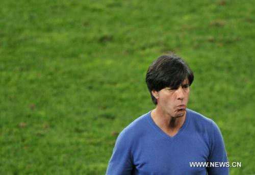 Germany's coach Joachim Loew reacts during the 2010 World Cup semi-final match against Spain in Durban, South Africa, July 7, 2010. Germany lost the match 0-1. (Xinhua/Xu Suhui)