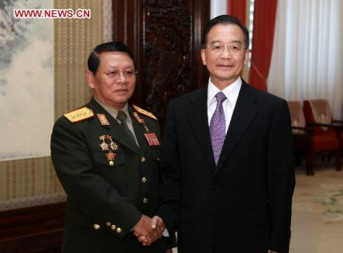 Chinese Premier Wen Jiabao (R) shakes hands with Douangchay Phichit, Lao Deputy Prime Minister and Defense Minister in Beijing, China on July 22, 2010. (Xinhua/Pang Xinglei)