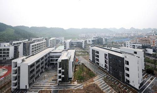 Photo taken on Aug. 3, 2010 shows the general view of the new Beichuan Middle School in Qiang Autonomous County of Beichuan, southwest China's Sichuan Province. The new Beichuan Middle School was completed and put into use Thursday. Some 3,000 teachers and students of the middle school will start a new semester in the school from Sept. 1, 2010. The former Beichuan Middle School was badly hit in the May 12 earthquake in 2008. More than 1,300 of the school's 2,900 students and teachers were killed or missing in the disaster. (Xinhua/Zhang Changming)
