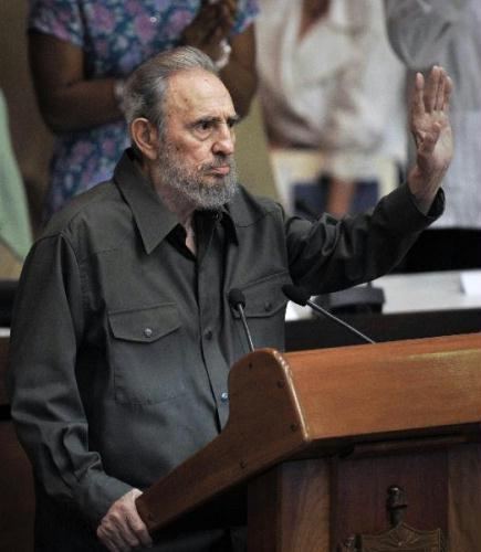 Fidel Castro waves at a meeting of the National Assembly of People's Power (Parliament), in Havana, Cuba, Aug. 7, 2010. This is the first time for Castro to appear in the National Assembly in four years following his emergency intestinal surgery.(Xinhua/AFP)