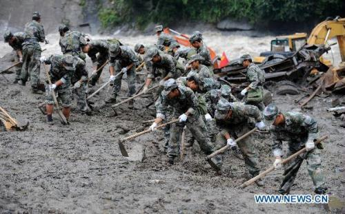 Rescuers work in Puladi Town, Gongshan of southwest China's Yunnan Province, Aug. 22, 2010. The death toll of the mudslides in Gongshan has risen to 23, with 69 others still missing as of 6:14 p.m. Saturday, said local authorities.(Xinhua/Lin Yiguang)