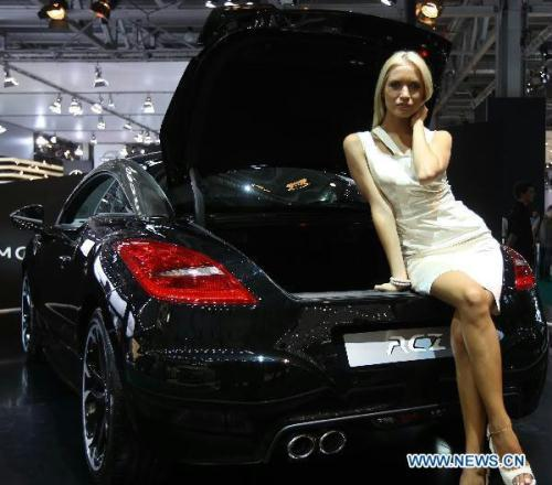 A model presents a Peugeot RCZ at the Moscow International Auto Show in Moscow, capital of Russia, Aug. 26, 2010. (Xinhua/Qu Haiqi)