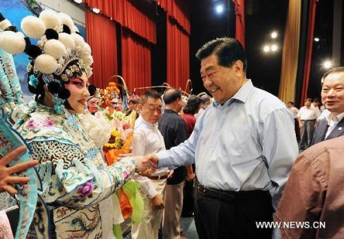 "Jia Qinglin (R, front), chairman of the National Committee of the Chinese People's Political Consultative Conference (CPPCC), who is also a memeber of the Standing Committee of the Political Bureau of the Communist Party of China Central Committee, shakes hands with the actors and actresses after watching the Peking opera named ""Female Warriors of the Yang Family"" in Beijing, capital of China, Aug. 28, 2010. (Xinhua/Rao Aimin)"