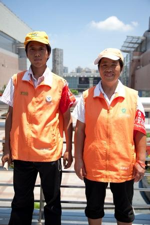 Chen Jianjun (left) and Ms Qiu Yuzhen, working as safety volunteers on the platform bridge.