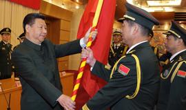 <font color=#002366><face:微软雅黑>中国人民解放军战区成立大会在北京举行 习近平向各战区授予军旗发布训令<br>(2016年2月1日)</font>