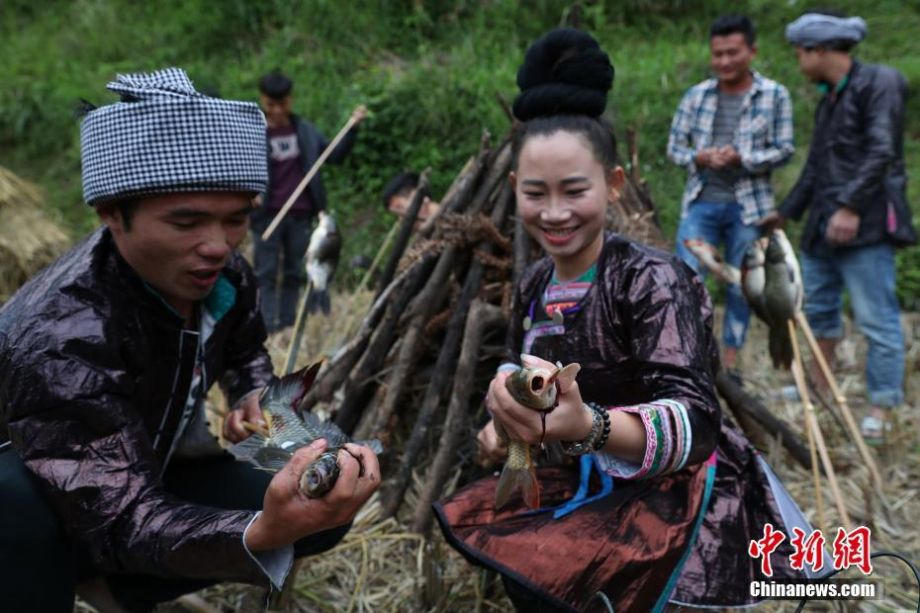 Miao People Celebrate Traditional Grilling Fish Festival