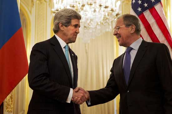 U.S. Secretary of State John Kerry, left, shakes hands with Russian Foreign Minister Sergey Lavrov before the start of their meeting at the Russian Ambassador