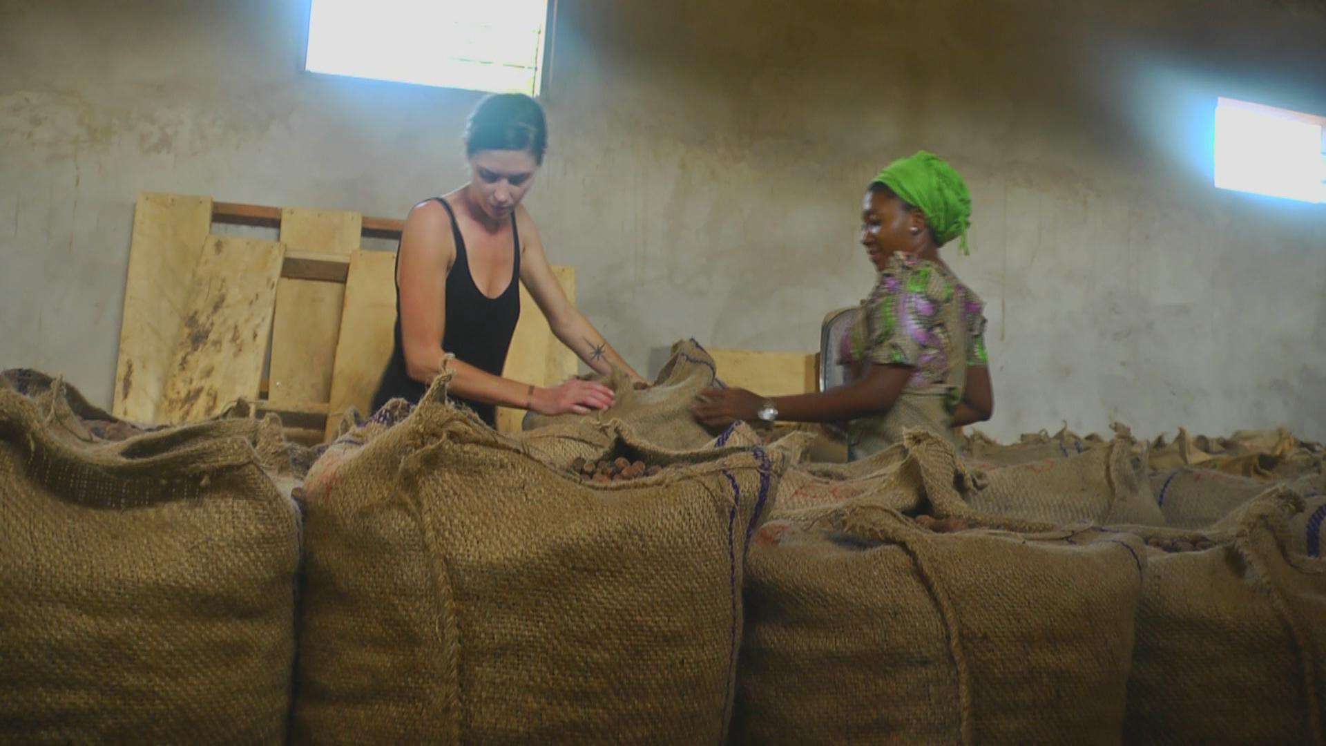 Danielle and Fatima Zubair - project Manager of Just Shea, Ghanain looking at the sacks full of shea nuts. Both women have dedicated their lives towards helping the women of Ghana through collecting shea nuts.
