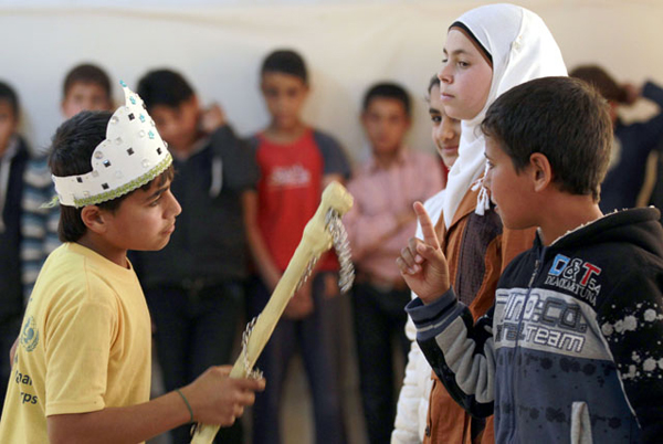 Syrian refugee Majd Ammari, 13, performs the role of King Lear during a rehearsal at the Zaatari Refugee Camp on March 8 (AFP photo by Khalil Mazraawi)