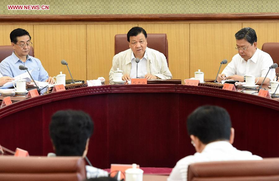 Liu Yunshan (C), a Standing Committee member of the Political Bureau of the Communist Party of China (CPC) Central Committee, presides over a meeting of the leading group of the Party