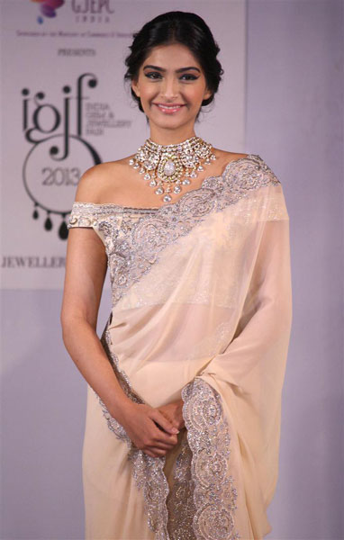 """Bollywood actress Sonam Kapoor, brand ambassador for the India International Jewelry Week 2014, also walks for the finale. The highlight of her look is a bridal headband called """"Arbor Amore,"""" created in a gold leaf design."""