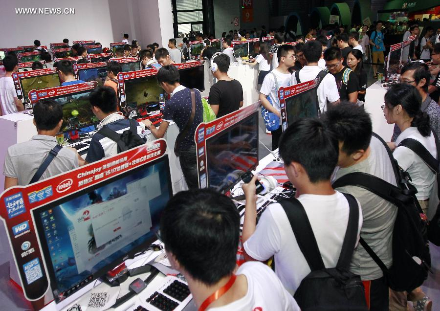 Visitors play games at the 12th China Digital Entertainment Expo & Conference (ChinaJoy) in Shanghai, east China, Aug. 1, 2014.