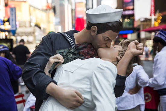 A six-foot statue reenacting the Times Square Kiss photo, taken by Alfred Eisenstaedt, is stands in in Times Square after its unveiling to mark the 69-Anniversary of the end of World War Two and victory over Japan on August 14, 2014 in New York City.