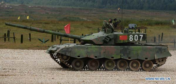A Chinese tank competes during the Tank Biathlon world championship in Alabino, Russia, Aug. 16, 2014. (Xinhua/Jia Yuchen)