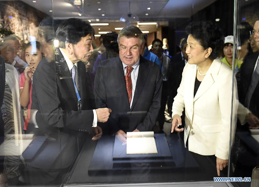 "Chinese Vice Premier Liu Yandong (front R) and President of the International Olympic Committee Thomas Bach (front C)visit the Nanjing Olympic Museum after the opening ceremony in Nanjing, Aug.17, 2014. Located in the north of the Youth Olympic Village, Nanjing Olympic Museum covers a building area of 7,896 square meters and an exhibition area of 5,034 square meters. Themed on ""Pass on the Century-old Flame in Youthful Nanjing"", the exhibition in the museum will show case nearly 600 pieces of objects of all kinds. (Xinhua/Yue Yuewei)"