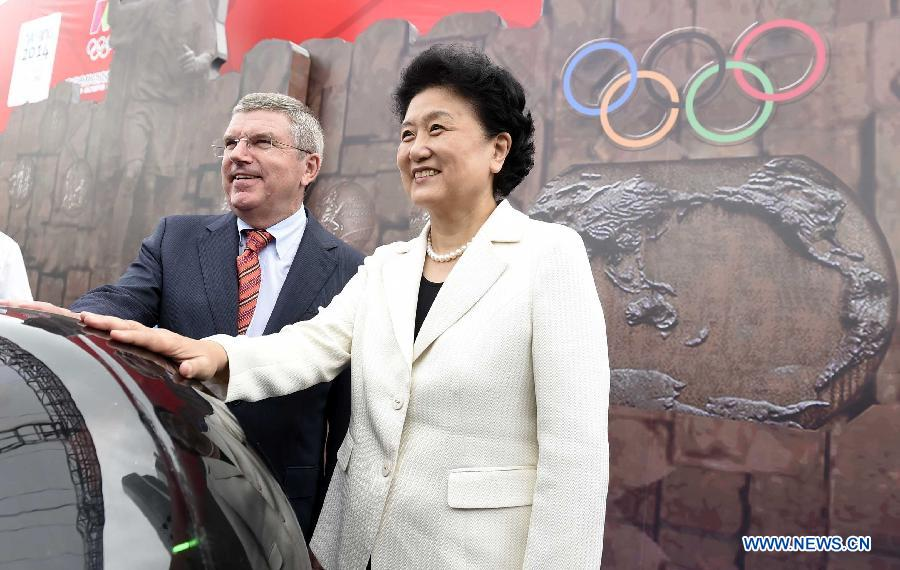 "Chinese Vice Premier Liu Yandong (R) and President of the International Olympic Committee Thomas Bach attend the opening ceremony of the Nanjing Olympic Museum in Nanjing, Aug.17, 2014. Located in the north of the Youth Olympic Village, Nanjing Olympic Museum covers a building area of 7,896 square meters and an exhibition area of 5, 034 square meters. Themed on ""Pass on the Century-old Flame in Youthful Nanjing"", the exhibition in the museum will show case nearly 600 pieces of objects of all kinds. (Xinhua/Yue Yuewei)"