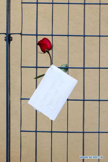 A flower is placed at the door of the Medical Legal Institute in memory of the victims of the plane crash, where the presidential candidate Eduardo Campos lost his life, in Sao Paulo, Brazil, on Aug. 16, 2014. According to local press, the funeral of the late presidential candidate Eduardo Campos will be held at Palacio do Campo das Princesas. The presidential candidate, 49 years old, and third in the national polls for the elections of October 5, died along with six other people when the Cessna 560XL crashed 75km from Sao Paulo. (Xinhua/Rafael Arbex/AGENCIA ESTADO)