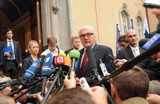 German Foreign Minister Frank-Walter Steinmeier(C) makes a statement before a urgent meeting in Berlin, Germany, on Aug. 17, 2014. Foreign Ministers of Russia, Ukraine, Germany and France held talks on Ukraine crisis in Berlin on Sunday. Steinmeier said new political impetus was urgently needed to resolve the crisis in Ukraine before the meeting. (Xinhua/Guo Yang)