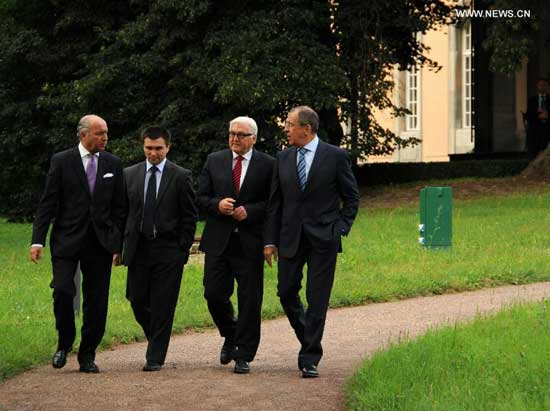 French foreign minister Laurent Fabius, Ukrainian foreign minister Pavlo Klimkin, German foreign minister Frank-Walter Steinmeier and Russian foreign minister Sergey Lavrov (From L to R) arrive for the urgent meeing in Berlin, Germany, on Aug. 17, 2014. The four foreign ministers held talks on Ukraine crisis in Berlin on Sunday. (Xinhua/Guo Yang)