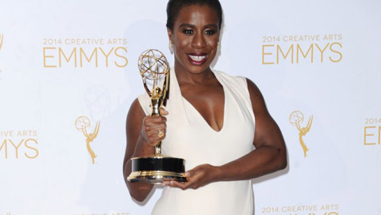 Aug. 16, 2014: Uzo Aduba poses in the press room with the award for outstanding guest actress in a comedy series for Orange Is the New Black at the 2014 Creative Arts Emmys at Nokia Theatre L.A.