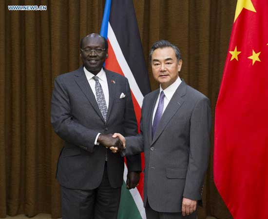 Chinese Foreign Minister Wang Yi (R) shakes hands with South Sudanese Foreign Minister Barnaba Marial Benjamin in Beijing, China, Aug. 19, 2014. (Xinhua/Wang Ye)