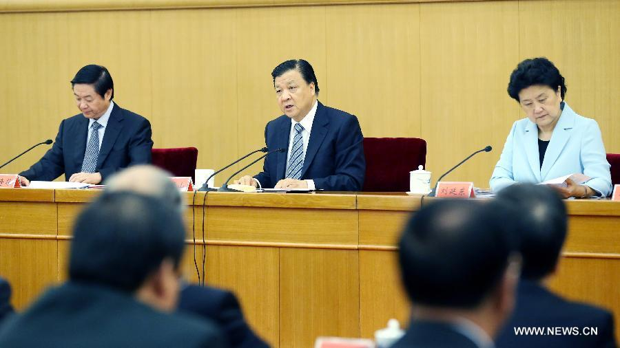 Liu Yunshan(C), a member of the Standing Committee of the Political Bureau of the Communist Party of China (CPC) Central Committee and secretary of the Secretariat of the CPC Central Committee, addresses a symposium to mark the upcoming 110th anniversary of the birth of late Chinese leader Deng Xiaoping, which falls on Friday, in Beijing, capital of China, Aug. 21, 2014. Deng was born on Aug. 22, 1904 in southwest China
