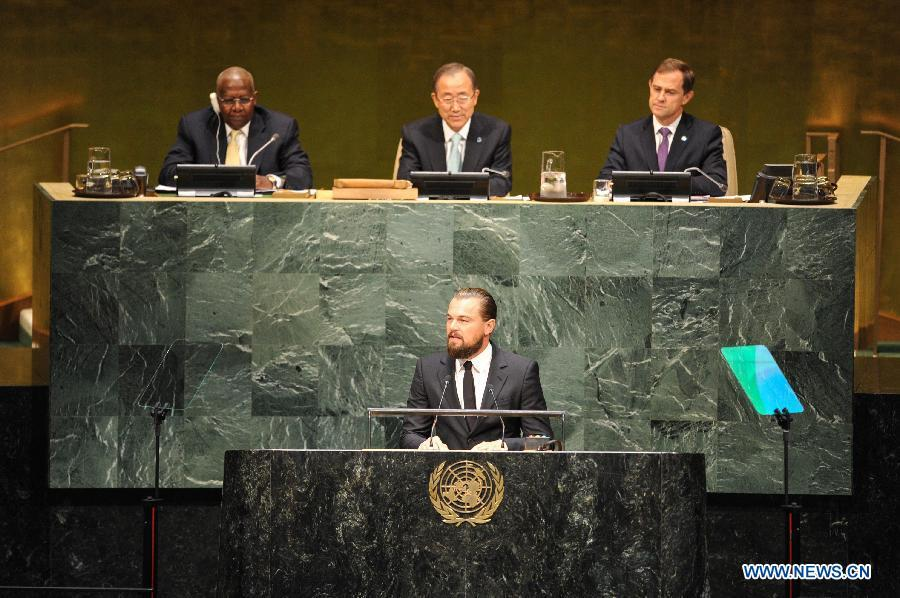 Leonardo DiCaprio (front), actor and UN Messenger of Peace, speaks during the opening ceremony of the Climate Summit at the UN headquarters in New York, on Sept. 23, 2014. The one-day summit, convened by UN Secretary-General Ban Ki-moon, is expected to galvanize global action on climate change. (Xinhua/Niu Xiaolei)