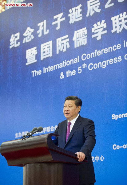 Chinese President Xi Jinping addresses an international seminar to mark the 2,565th anniversary of the birth of Confucius, which is concurrent with the Fifth Congress of the International Confucian Association (ICA), at the Great Hall of the People in Beijing, capital of China, Sept. 24, 2014. (Xinhua/Huang Jingwen)
