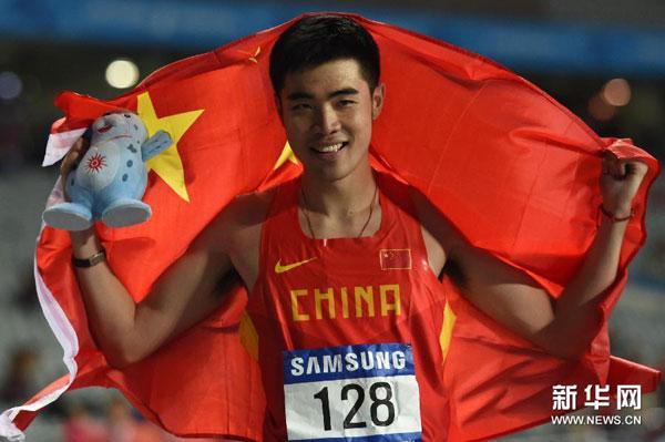 Xie Wenjun marcando 13 segundos con 36 milésimas en los 110 metros con vallas masculino