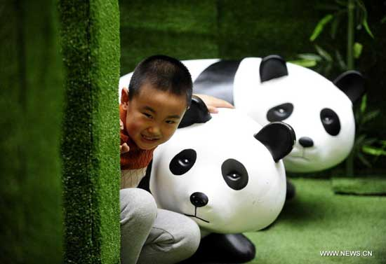 A boy explores a panda-themed labyrinth at a shopping mall in Shenyang, capital of northeast China