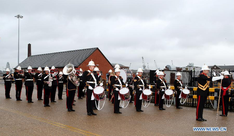 Photo taken on Jan. 12, 2015 shows Royal Marines Band performing ahead of the welcoming ceremony for the 18th convoy fleet sent by the Chinese People