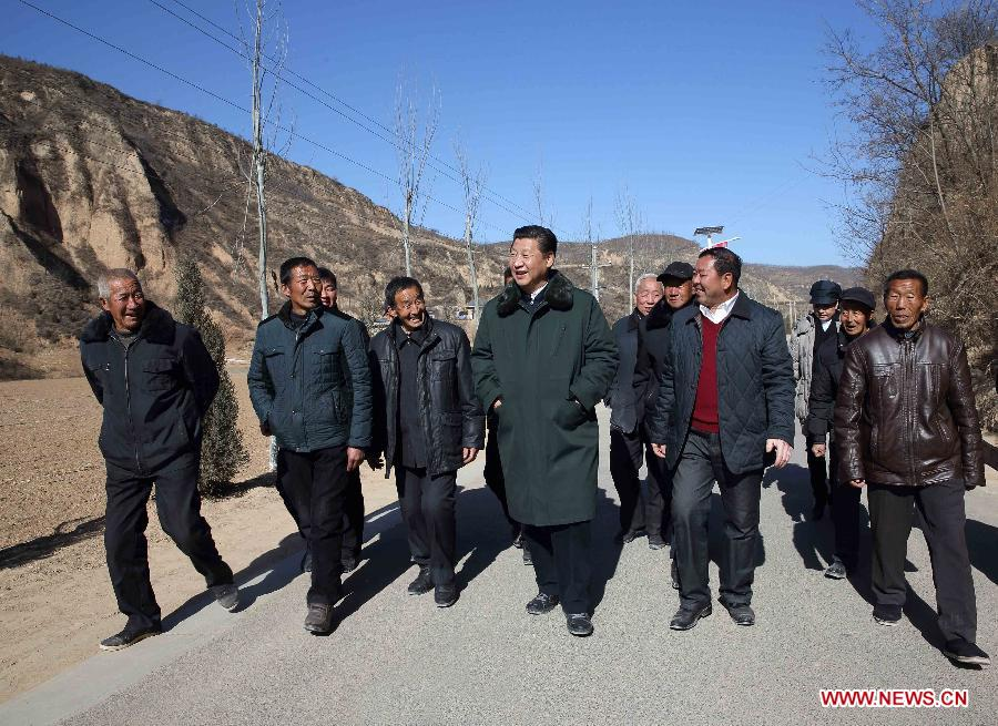 Chinese President and General Secretary of the Communist Party of China Central Committee Xi Jinping (C), also chairman of the Central Military Commission, visits people in Liangjiahe Village, Wen