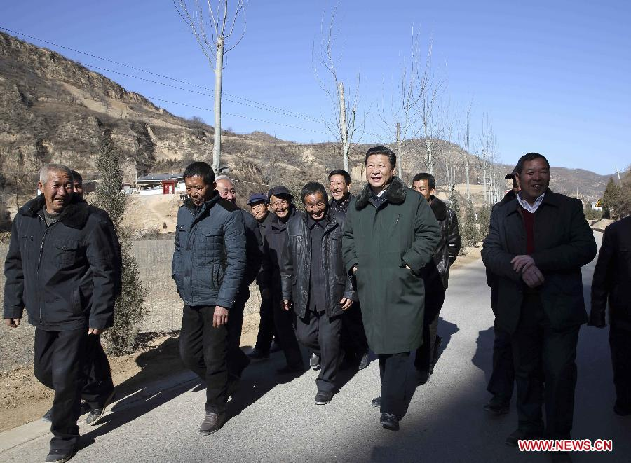 Chinese President and General Secretary of the Communist Party of China Central Committee Xi Jinping (2nd R front), also chairman of the Central Military Commission, visits people in Liangjiahe Village, Wen