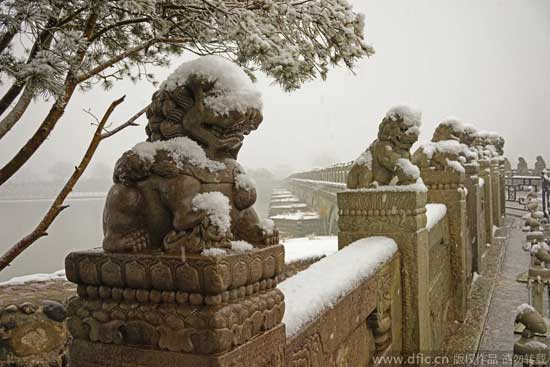 Stone lions covered in snow are pictured on Feb. 20, 2015. A snowfall hit China