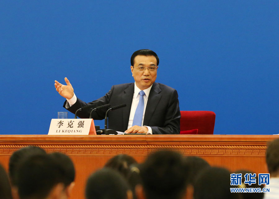 Chinese Premier Li Keqiang speaks at a press conference after the closing meeting of the third session of China