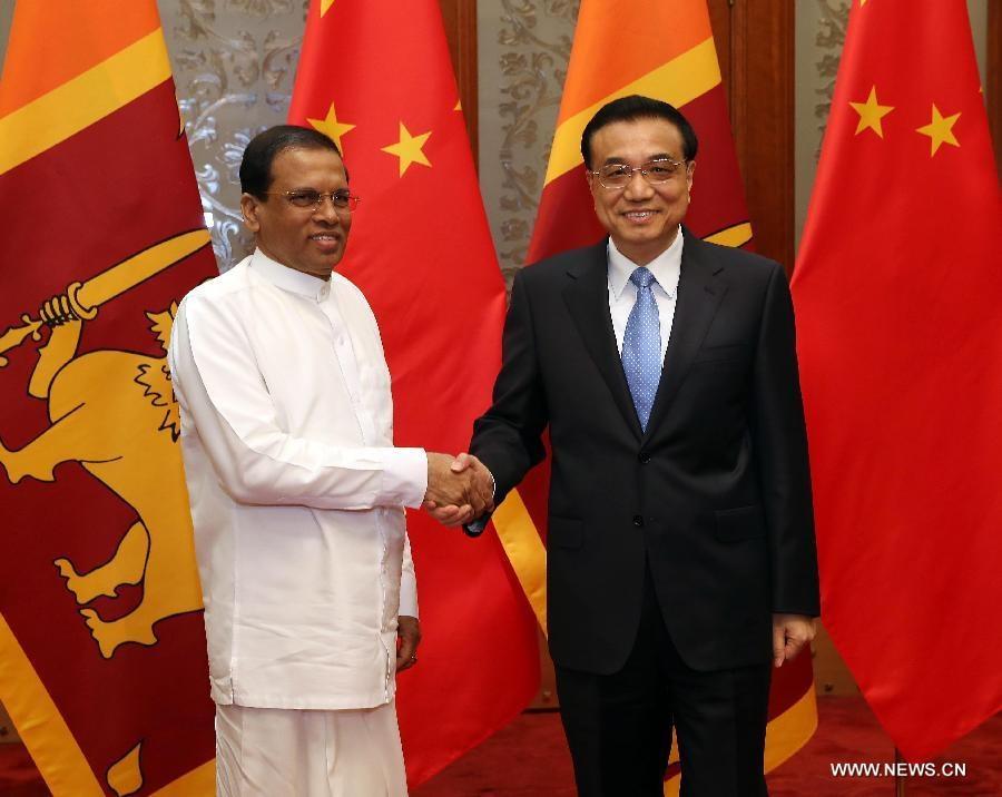 اجتمع لي كه تشيانغ مع الرئيس السريلانكي الزائر مايثريبالا سيريسينا