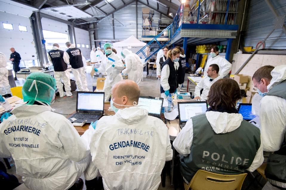 Forensic experts of the French gendarmerie disaster victim identification unit (UGIVC) work under a tent near the site of the crash of a Germanwings Airbus A320 in which all 150 people on board were killed.