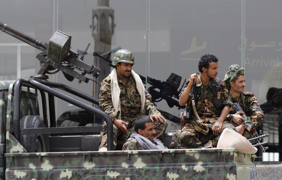 Shiite rebels, known as Houthis, wearing an army uniform, ride on an armed truck to patrol the international airport in Sanaa, Yemen, Saturday, March 28, 2015.