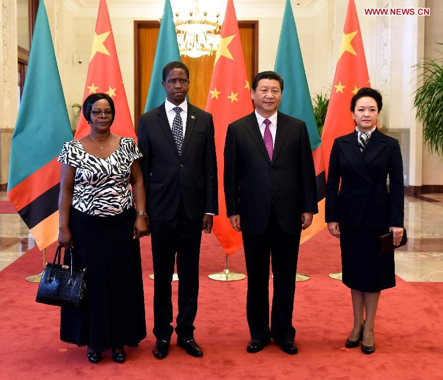 Chinese President Xi Jinping (2nd R) poses for photos with Zambian President Edgar Lungu (2nd L) at a welcome ceremony in Beijing, capital of China, March 30, 2015. (Xinhua/Rao Aimin)