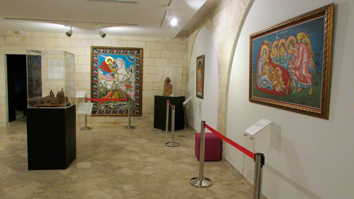 Johnny Adonieh's icons on display alongside an olive-wood replica of the Nativity Church
