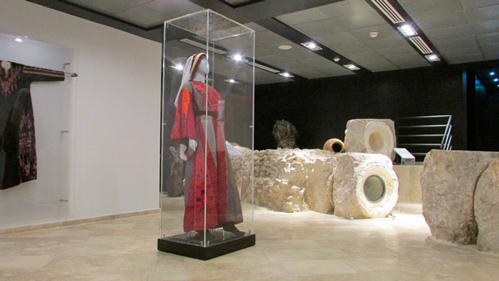 The ancient Roman aqueduct runs through the Museum passing many treasured objects including this traditional dress and headdress, proudly on display