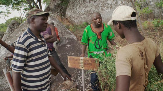 Moses confronting a young man who had stolen some materials from one of the historical sites in Mangochi, a Southern region in Malawi.